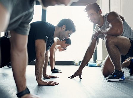 Shot of a fitness group having a workout session at the gym